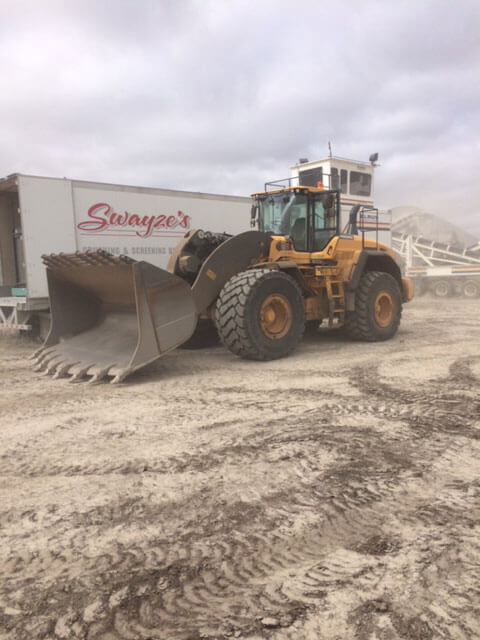 Loader at the crusher